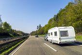 Caravan Or Recreational Vehicle Motor Home Trailer On A Freeway Road poster