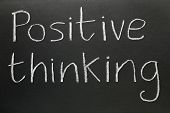 stock photo of positive thought  - Positive thinking written in chalk on a blackboard - JPG