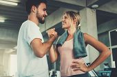Attractive Young Couple Handshaking After Workout In Fitness Gym., Portrait Of Man And Woman Couple  poster