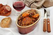 Sausages And Meat With Red Beans And Glass Of Red Wine