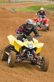 Atv Motocross Rider Racing Down The Straight