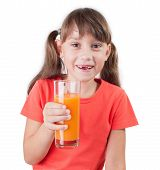 image of edentate  - Pretty happy little girl with a glass of juice - JPG