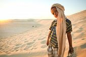 Tunisian boy in Sahara