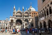 16. Jul 2012 - Unidentified Tourists Walking In St Marco Square, In Front Of Doge's Palace In Venice