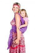 Happy Mother Carrying A Baby Girl In Sling Isolated On White Background