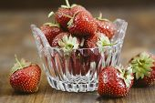 Beautiful red strawberries in a small glass taster
