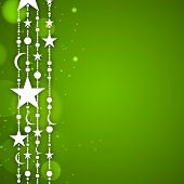 Muslim community festival Eid Al Fitr ( Eid Mubarak) concept with hanging stars on green background.