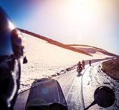 Group of bikers on snowy road, active lifestyle, adventure trip, extreme  moto sport, off-road trans