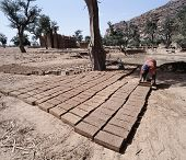 stock photo of mud-hut  - Brick production Dogon village Kani - JPG