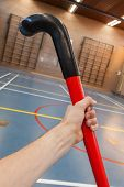 Hockeystick In An Old School Gym