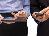 woman and man hands with smartphone and tablet pc