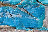 Detail Of Peeling Paint On Old Brick Wall