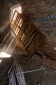Sunbeams Streaming Through Window Of Abandoned Building