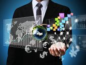 image of international trade  - businessman with financial symbols coming from hand - JPG
