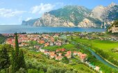 The Lake Garda (Lago di Garda or Lago Benaco) and The Nago - Torbole city. Italian largest lake is l