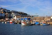 stock photo of lobster boat  - boats moored in Brixham harbour in Devon - JPG