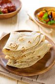 Chapati or chapatti, Indian dhal and chicken curry, popular Indian food.