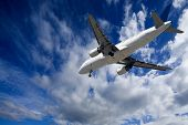 stock photo of blue sky  - view from the bottom of an aircraft landing with the sky background - JPG