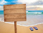 picture of rough-water  - wood sign on beach - JPG