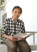 Senior Woman 70 Years Old Reading Book