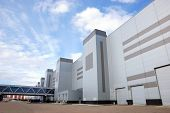 stock photo of building exterior  - Modern industrial building over the blue sky - JPG