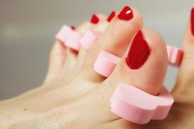pic of painted toes  - foot pedicure applying woman - JPG