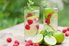 image of peppermint  - fresh cold drink water ice cubes peppermint lime raspberry outdoor summer - JPG
