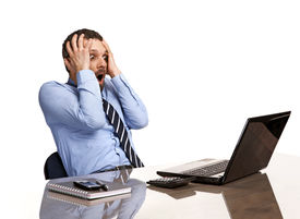 picture of not found  - shocked businessman in panic looking at a laptop screen  - JPG
