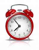 stock photo of punctuality  - Red alarm clock on white background - JPG