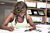 Pretty Black African Student Girl Reading Books In Library