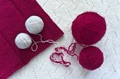 picture of knitwear  - Magenta and white clews are on knitwear - JPG