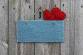 Antique blue sign with red hearts