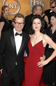 Gary Oldman and wife Alexandra at the 15th Annual Screen Actors Guild Awards. Shrine Auditorium, Los Angeles, CA. 01-25-09