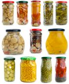 pic of yellow milk cap  - Set of different berries mushrooms and vegetables conserved in glass jars isolated on the white background - JPG