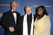 Michael Apted with Roger Ebert and wife Chaz in the press room at the 61st Annual DGA Awards. Hyatt