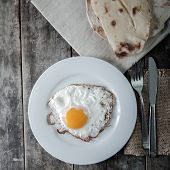 Fried Eggs With Bread In Plate