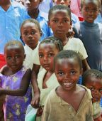 An assortment of African children looking and smiling at the camera