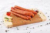Wooden Chopping Board With Sausages And Spices