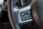 Audio Control Buttons On Steering Wheel Of Car