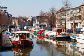 pic of flatboat  - Boats parked along the channel in the city of Mechelen  - JPG