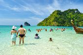 Tourist on the beach of Krabi , Thailand