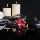 Beautiful Spa Concept Of Zen Stones With Drops, Purple Orchid (phalaenopsis), Candles With Reflectio