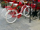 WROCLAW, POLAND - JUNE 07:Two Bikes For Women And Men, Painted White And Red Standing In A Rack