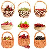 Collage of berries in baskets isolated on white