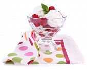 Creamy ice cream with raspberries on plate in glass bowl, isolated on white