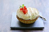 tart with lemon cream and meringue decorated with currants