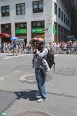 Unidentified photographer taking pictures during  LGBT Pride Parade in New York