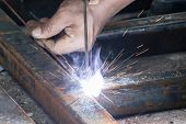 Woker Welding Steel With Sparks Lighting