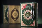 stock photo of tasbih  - Islamic Books of Holy Quran on Soft Light Background - JPG