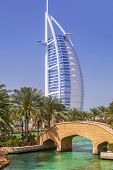 DUBAI, UAE - 1 APRIL 2014: View for Burj Al Arab hotel from the Madinat Jumeirah in Dubai, UAE. Burj